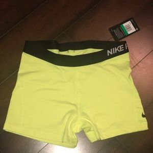 Neon yellow Nike shorts
